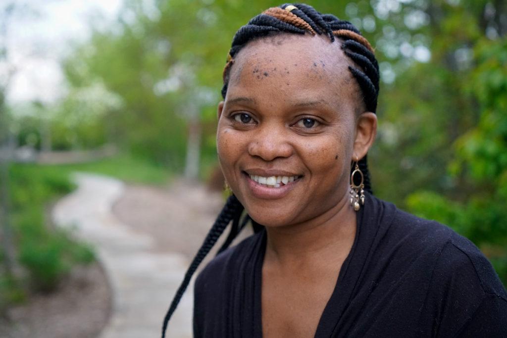 Monique's Hot Kitchen founder Monica Wachira smiles at the camera.