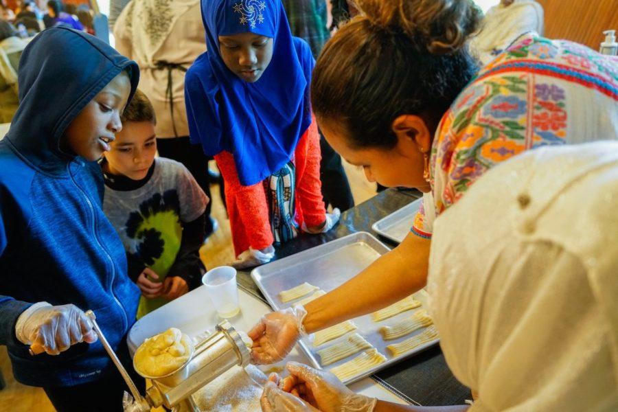 Children make Somali biscuits