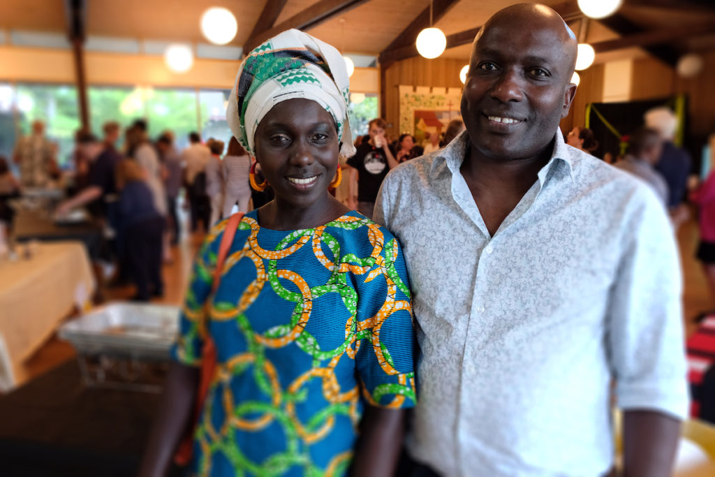 East and West Catering co-owners Adama Jammeh and Lamine Sarr smile at the camera.