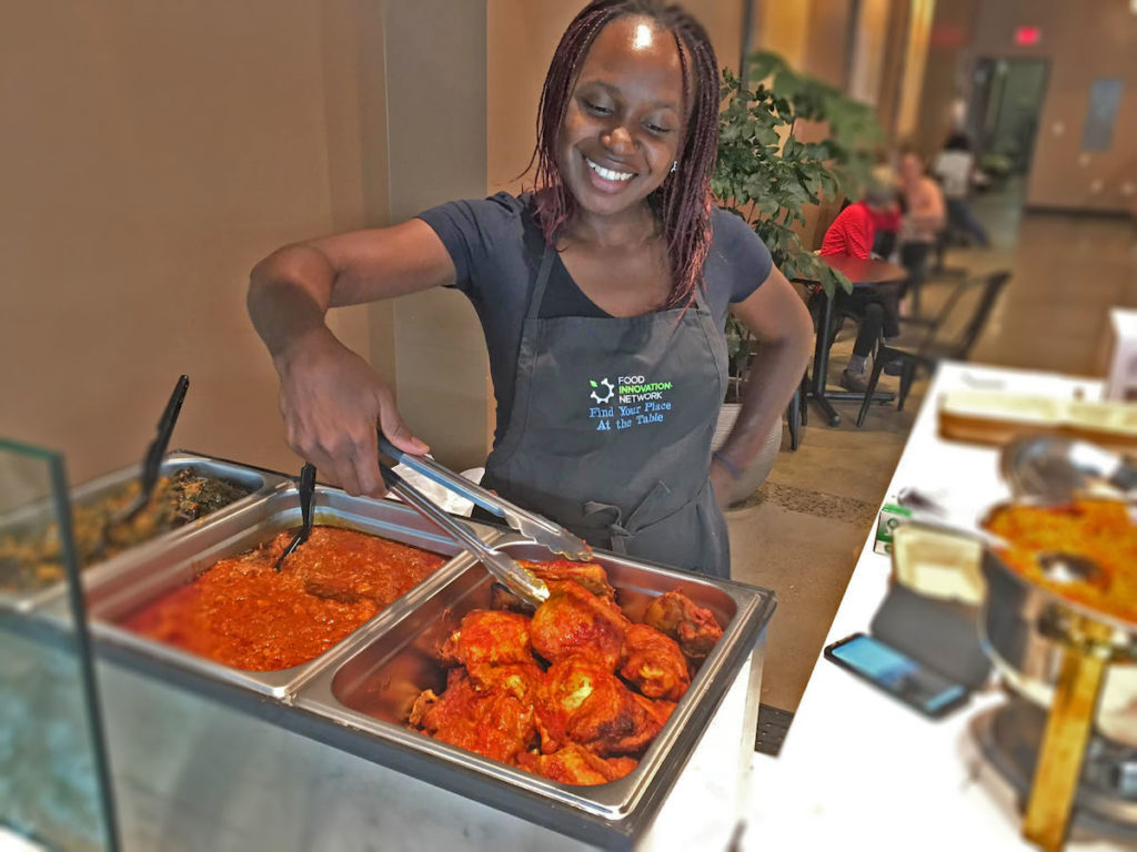 Naija Buka owner Lilian Ryland serves food at a pop-up lunch