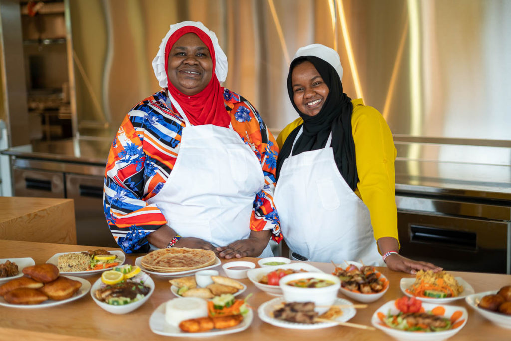 Moyo Kitchen co-owners Mwana Moyo and Batulo Nuh showcase a selection of the food they offer at Spice Bridge.