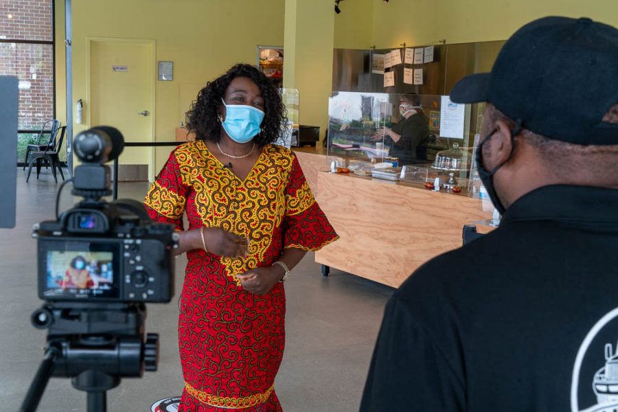 Caroline Musitu talks to an interviewer as a camera records her.