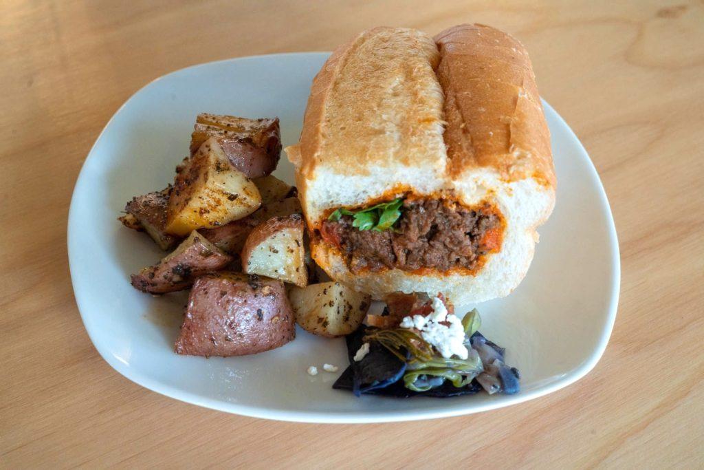WUHA's beef roast sandwich with roasted potatoes
